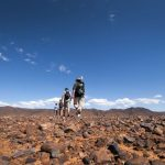 Flinders Ranges Walking Tour with Park Trek - Hikers traversing rocky grounds