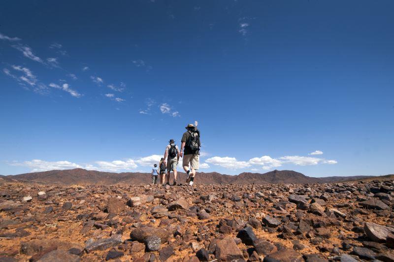 Flinders Ranges Walking Tour with Park Trek - Hikers traversing rocky grounds