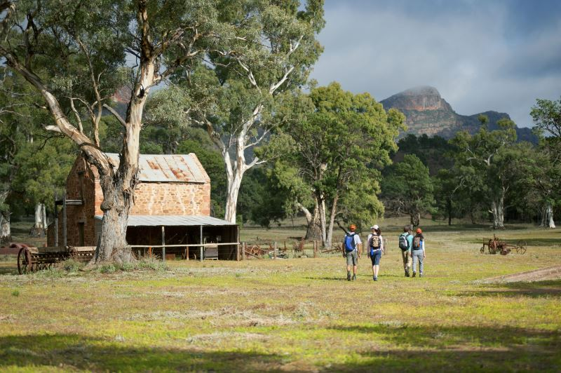 Flinders Ranges Walking Tour with Park Trek - Hikers walking past an old homestead