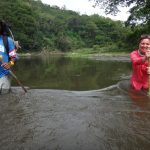 Wading through a river on Fiji
