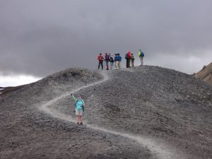 Hikers against a dramatic grey Icelandic sky