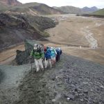 Hikers on their way up an Icelandic mountain