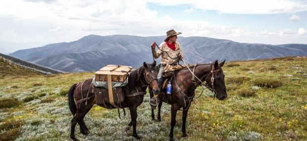 man with packhorse