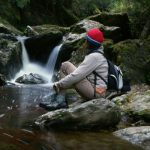 Relaxing by the falls in the Tasmanian wilderness