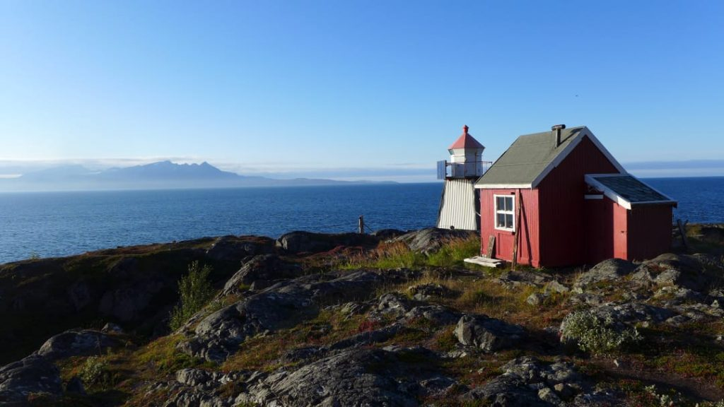 Hike the Lyngen Peninsula, lighthouse and red cabin, Norway